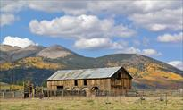Barn on Cline Ranch with mountains in background
