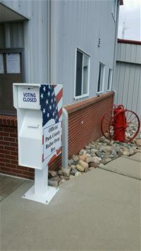 Platte Canyon Fire voting box with American flag design outside building